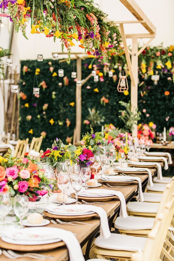 modern bohemian wedding inspiration // hanging garland, hanging flowers, floral chandelier, tablescape, feasting table, long table, centerpiece, bright flowers, summer wedding