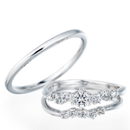 セットリング WLD-112 × WLR-11 × WLR-12 WLD-112エンゲージとマリッジのセット。エンゲージは、ダイヤモンドの連なりが美しいエレガントなデザイン。 マリッジは、手もとを見るたびに愛着がわく可愛らしいデザイン。 5石のダイヤが入り、エンゲージと重ねてつけるとより華やかな印象を楽しめます。 男性用は、普段リングをつけなれない方にも違和感なくご使用いただけるシンプルで、つけ心地の軽やかな結婚指輪(マリッジリング)です。