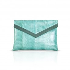 MIAMI   Slither into style this season with this envelope phyton clutch. Remaining chic and elegant, this clutch will add a pop of color to any outfit. With inside pocket. Designed for a naturally stylish clientele for whom the handbag is not merely an accessory but a projection and confirmation of her own image.