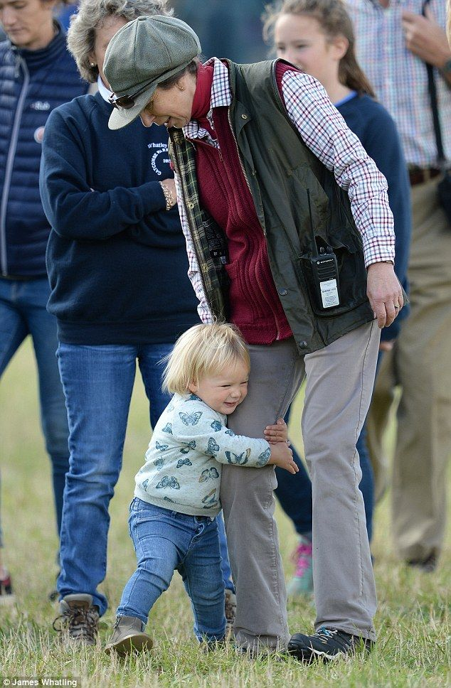 Mia Tindall hugs her Grandmother Princess Anne's leg as they watch the Whatley Manor Gatcombe Horse Trials, Gatcombe Park, Minchinhampton, Gloucestershire