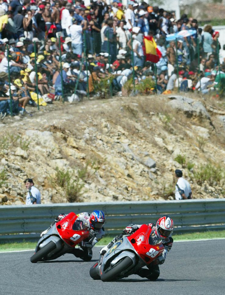 Proton Team KR riders Jeremy McWilliams and Nobuatsu Aoki at Estoril.