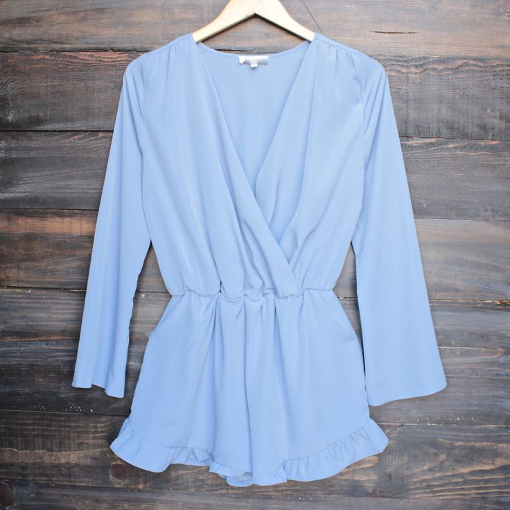 front wrap romper with ruffle hem in lilac