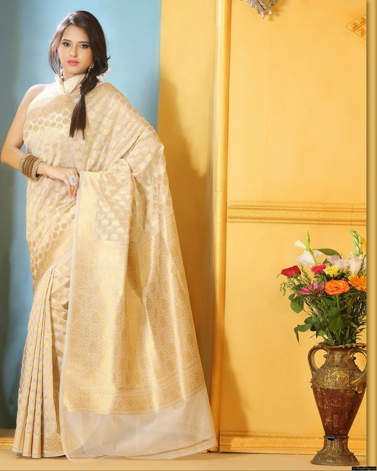 Add An Off-White Banarasi Style Bridal Silk Saree In Your Wardrobe.  As a bride if you are wearing a silk saree then you will feel the heaviness of saree but at the same time due to its soothing silk thread it will be always a comfort. You will definitely know the difference between silk saree that are widely available in the market.