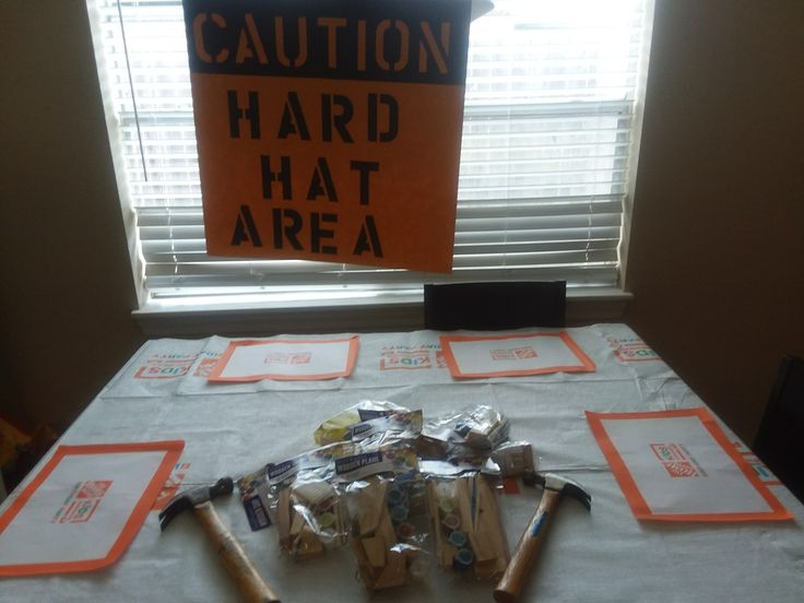 Building kits sere purchased at walmart. Party supplies (table cover and mats) from home depot online sign was hand made.
