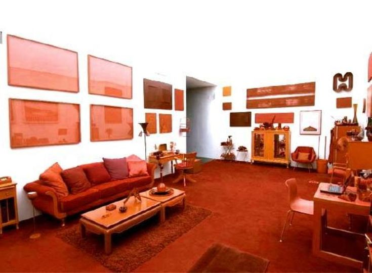 Monochromatic Color Scheme 2. This sitting area has many shades of orange  in it. The couch and the floor