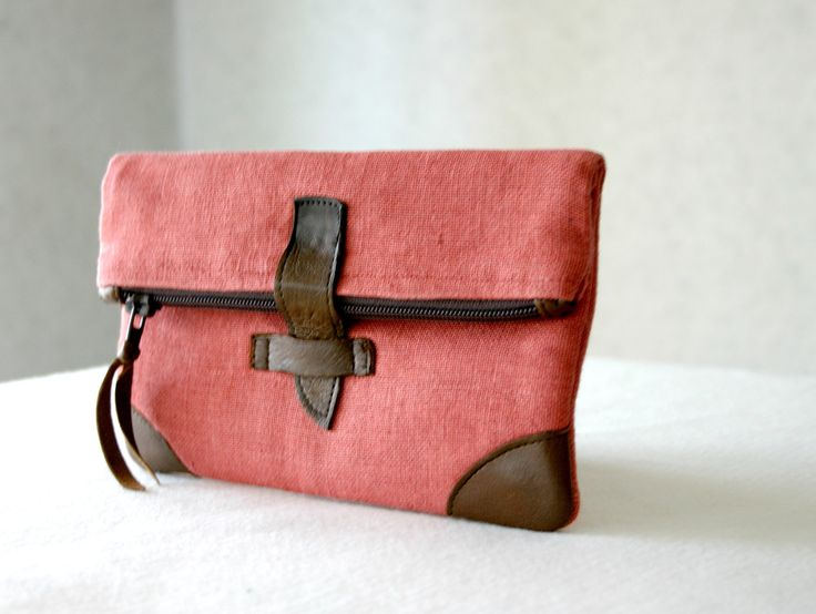Linen and leather foldover small clutch purse, cosmetic bag, make up bag, pencil pouch. $25.00, via Etsy.