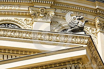 Architectural detail with griffin on the frontispiece of the Athenaeum edifice in Bucharest, Romania.