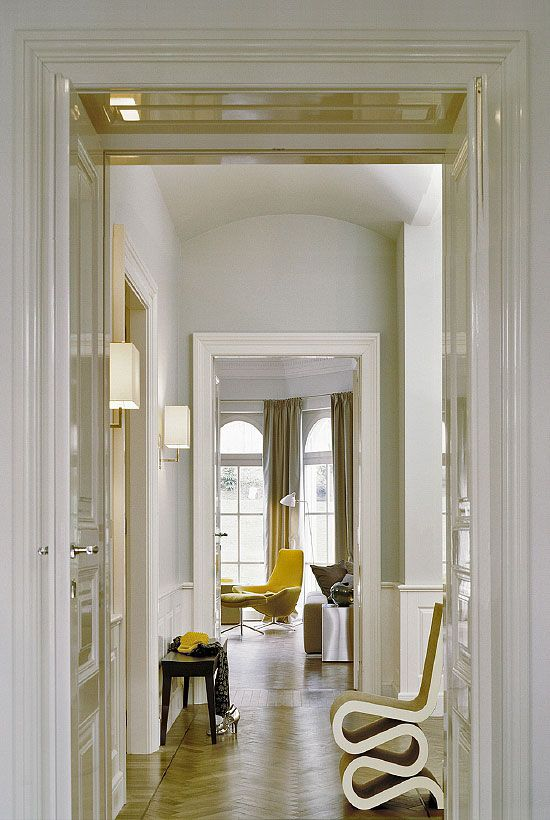 White laquer, wainscot, sconce, draperies