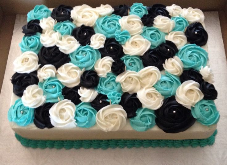 Very happy with my white, blue and black rosette cake turned out!