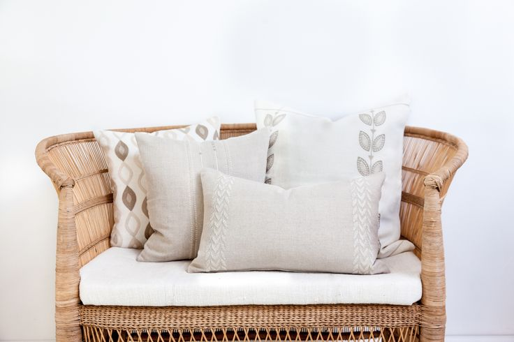 100% linen hand embroidered pillows look perfectly styled on this wicker bench // shop on ARTHA Collections #handcrafted #interiordecor #lvingroomstyling #linenpillows #throwpillows #cozy #hygge #lagom