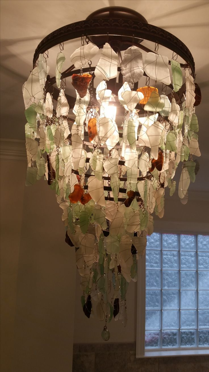 Sea glass Chandelier. Made from the sea glass on the Puerto Rico Beaches. My daddy's aunt made this for her daughters house!