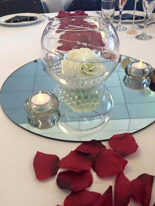 Simple yet beautiful centrepiece.  Hire from www.allureweddings.co.nz