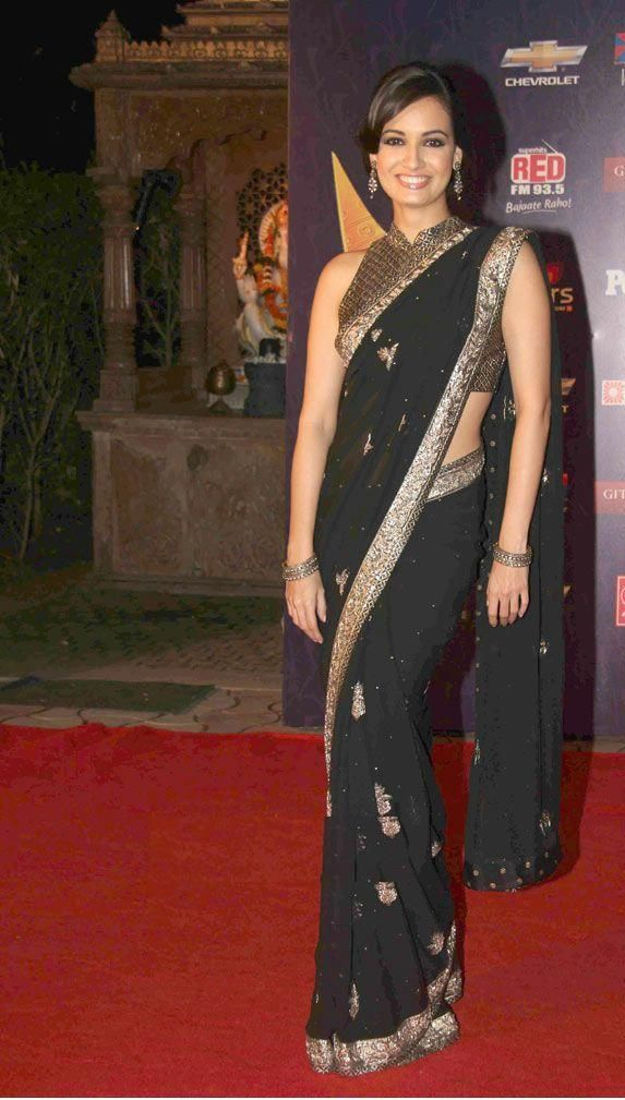 Dia Mirza in black and gold sari. One of those Bollywood celebs who is best dressed most of time.