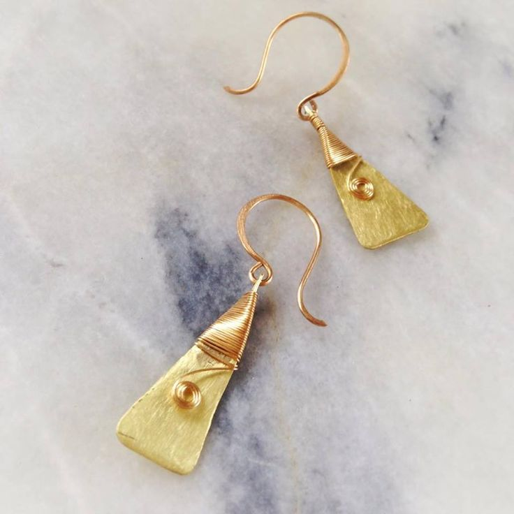 Tiki Kiwi Designs golden toki earrings meaning strength and courage NZ$685