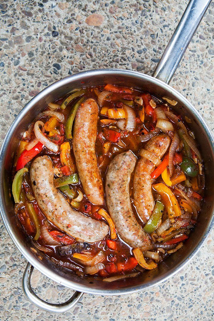 Sausage, Peppers, and Onions ~ Italian sausages cooked with bell peppers, sweet onions, crushed tomatoes, and garlic.  Served in a hoagie roll or over pasta or polenta. ~ SimplyRecipes.com