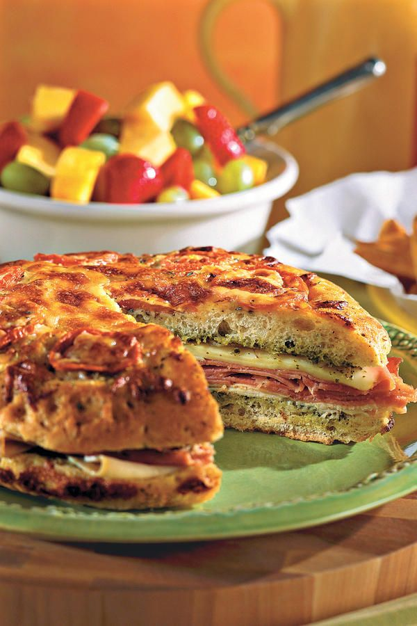 "Online User Comment: ""We have been using this recipe for many years now and it's still a big favorite at our house. We make it using french bread loaves instead of the foccacia and serve with our favorite soup."" -Kathy Buratti Pesto Focaccia Sandwich"