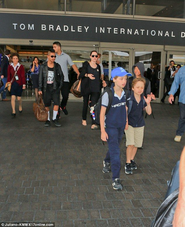 All in a row: The director held hands with daughter Vivienne as the rest of their kids whi...