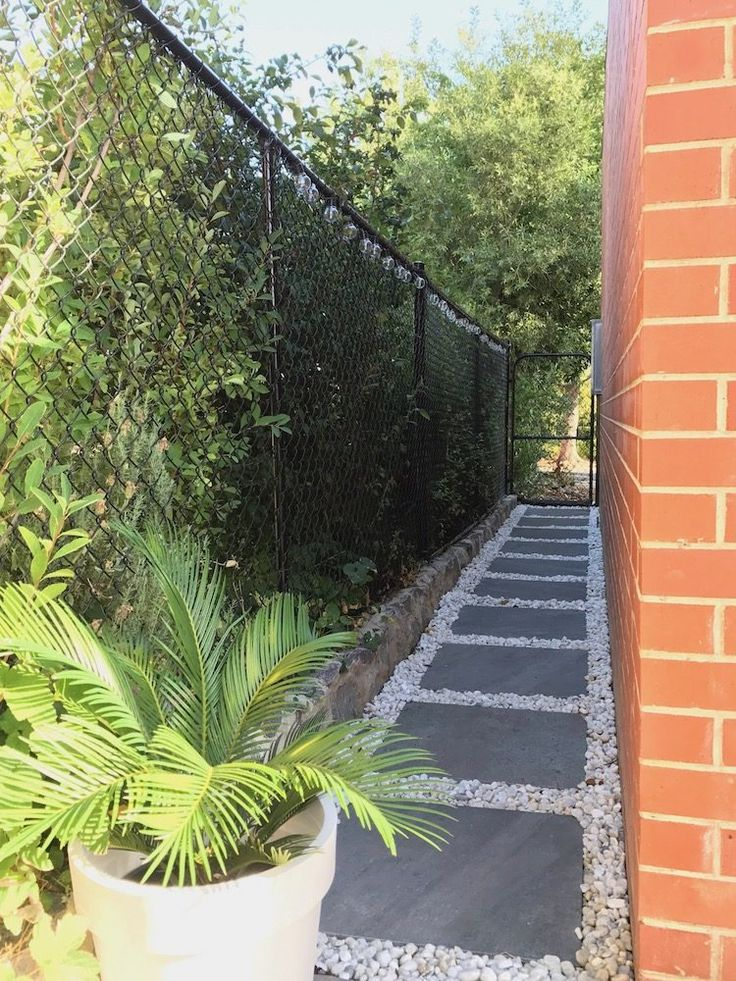 HOW TO CREATE A GARDEN PATH: then put your pebbles down and stomp on them to compress them into place. Click on the image above to get all the steps on how to create a garden path.