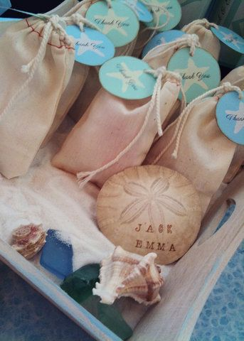 wedding favors - fill muslin bags or small mason jars with sand and seashells and add a vintage style tag with the wedding date