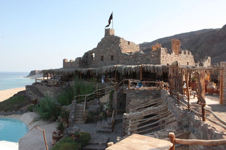 Castle Zaman is a new concept for an outing in the middle of the desert which at the same time overlooks the sea. Located on the Taba-Nuweiba road in Al-Borqa Mountain, in the middle of what is known as the Golden Beach, 35 metres above sea level, lies Castle Zaman, famous for its golden sand, sapphire waters, colourful corals and where the mountains come right to the edge of the sea.  www.vantage-travels.com