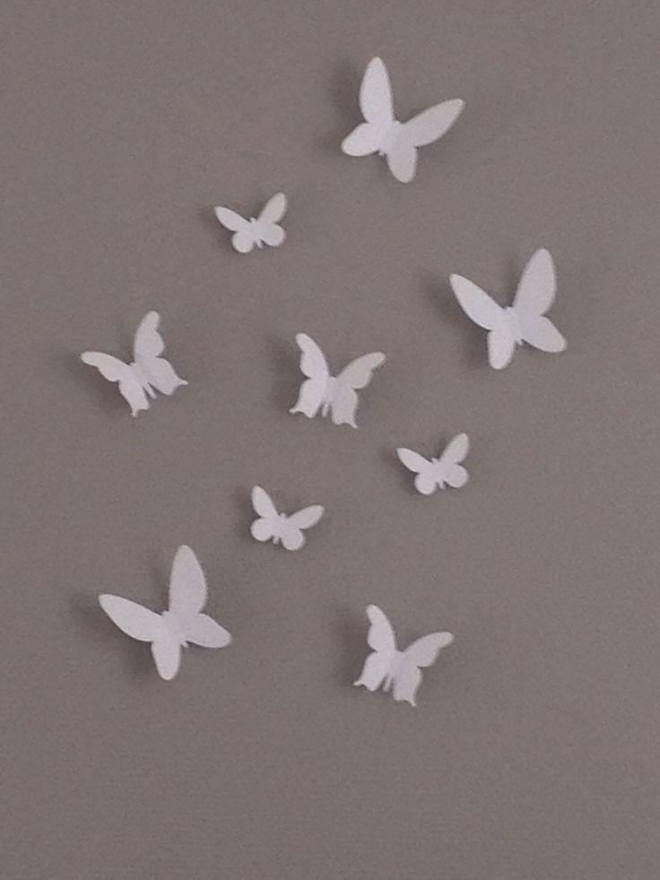 3D vlinders op muur