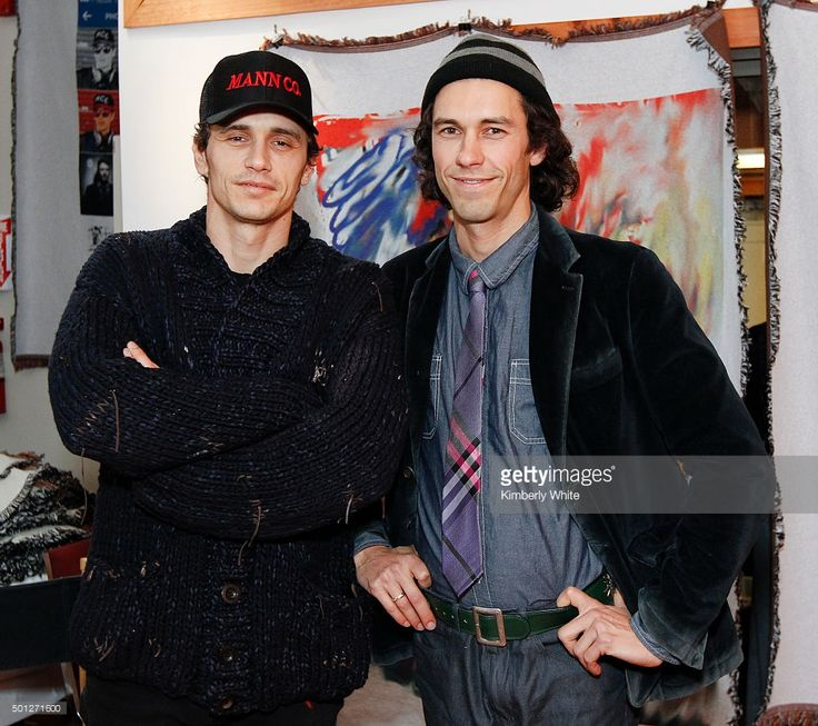 James Franco (L) and Tom Franco at the Art of Elysium reception for Tom and James Franco's BRO-MANCE at the Firehouse Collective on December 13, 2015 in Berkeley, California.