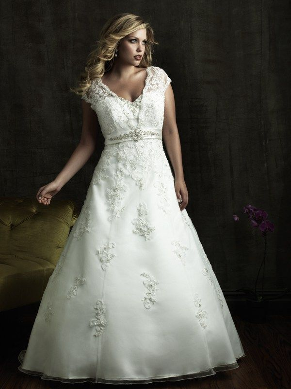 W271 Allure Women Bridal Gown - Delicate lace appliqué accent this entire design. This A-line wedding gown features beautiful cap sleeves, V-neckline, and a satin band at the empire waist with sparkling crystal.