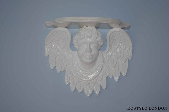 Decorative wall shelf with a cupid angel in by Kostylolondon