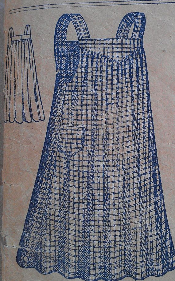 This is an original unprinted sewing pattern. It has been previously used. Apron has shaped yoke front and wide straps. Gathers at yoke of