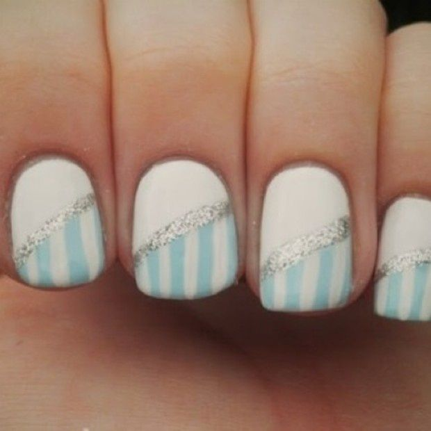 Blue and White striped nail art with silver glitter.
