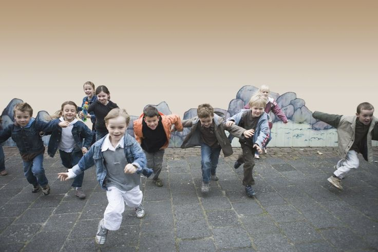 Schoolchildren (5-7) running in playground