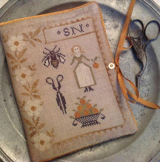 A Stacy Nash design (sewing book and pinkeep) for the Orange Coast Sampler Guild.  I absolutely love this.