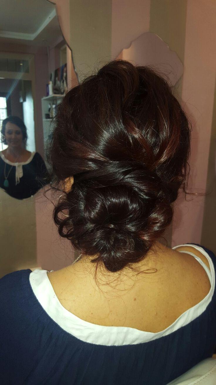 Low loose bun. Hair by Adru Hugo