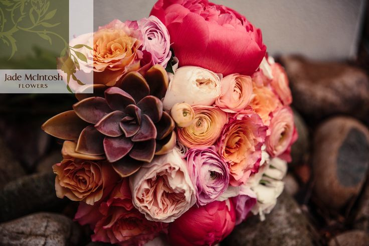A gorgeous copper succulent finishes off Emilee's bouquet of coral peonies, roses and ranunculus. www.jademcintoshflowers.com.au www.candicecampbellphotography.com