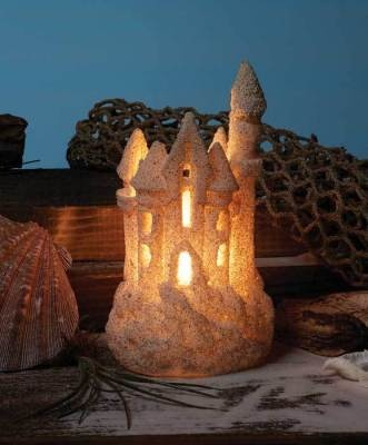 Sandcastle Luminary - Too lovely to be swept away by high tide... enchanted light is emitted from a storybook abode.