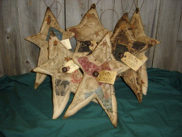 Old Grungy...quilt stars with rusty metal stars & prim tag.