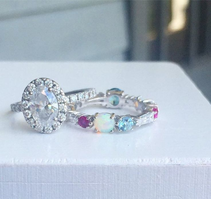 Katie Diamond custom wedding band. This band includes the birthstones of the bride, groom & their children!