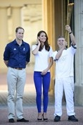 JULY 26 2012 – The royal couple met John Hulse, who carried the Olympic Torch past Buckingham Palace, the day before the London 2012 Opening Ceremony. The Duchess wore a Team GB polo shirt, Zara cobalt jeans and Stuart Weitzman wedges.