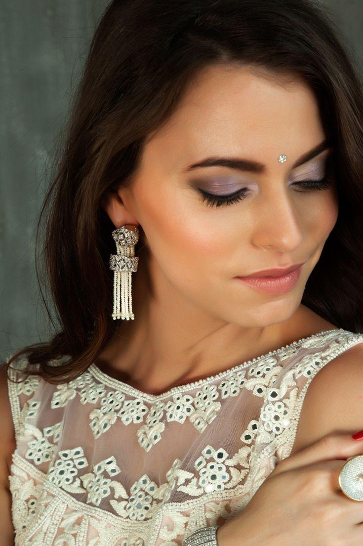 American diamonds earrings with pearl dangling in rhodium plating