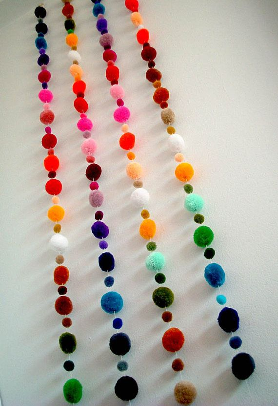 Make colorful pom pom garlands for your next celebration by stringing Pom poms on fishing wire.