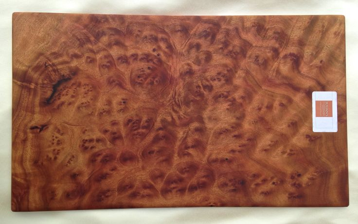 Camphor burl wood cutting board:  51 cm x 30cm x 1cm