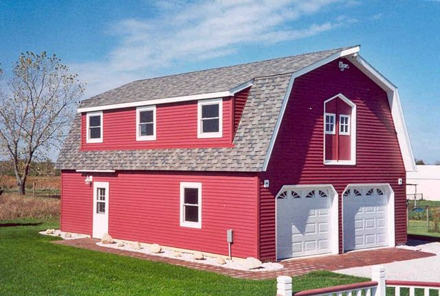 Barn style home with gambrel roof and large shed dormer for Gambrel style barn