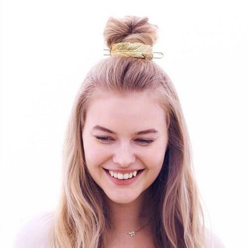Boho bun cuff. Gold feather bun cuff. Hair jewelry. Hair accessories built to last. Backed by a lifetime guarantee. On trend. Half bun on long blonde tresses, perfect for a bohemian prom hair do or beach wedding. Beach hair don't care. Summer 2017. Long straight hair styles.