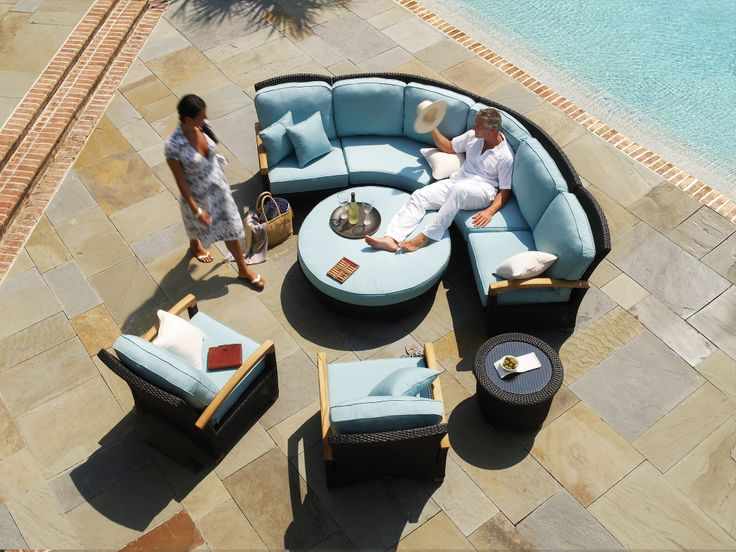 Wicker patio sectional furniture. Gloster's Plantation collection features teak arms.