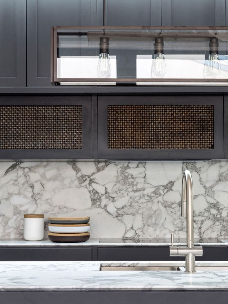 Kitchen Design Idea - How To Add Marble In Your Kitchen // There's an industrial modern feel in this kitchen created by the Edison bulbs in the steel light fixture and the marble backsplash / countertops on both the island and the back wall.