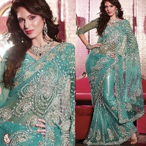 Rocking Embroidered Georgette Saree -- Create a rocking impact with your presence by draping this Deep Cambridge Blue georgette saree emblleshed with 5 kali fusion with zaricon, silver cutdana, stone and sequins work.This beautiful saree is coupled with matching blouse. Representing the luxury and elegance of contemporary charm. Our sarees in this wedding collection are very delicately hand embroidered with the finest quality of crystals and zircons. $339