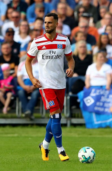 Mergim Mavraj of Hamburg runs with the ball during the preseason friendly match between Holstein Kiel and Hamburger SV at Gruemmi-Arena on July 19, 2017 in Kiel, Germany.
