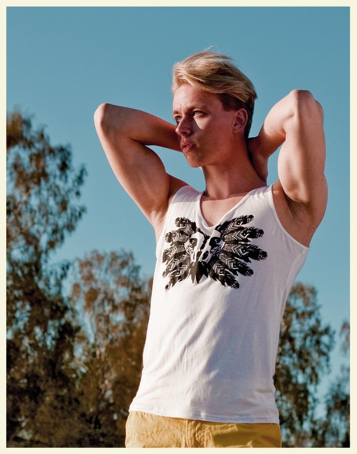 Beautiful and manly. Striking a pose in tank from our Indian Summer collection #menintanks #beautifulmen #eyecandy