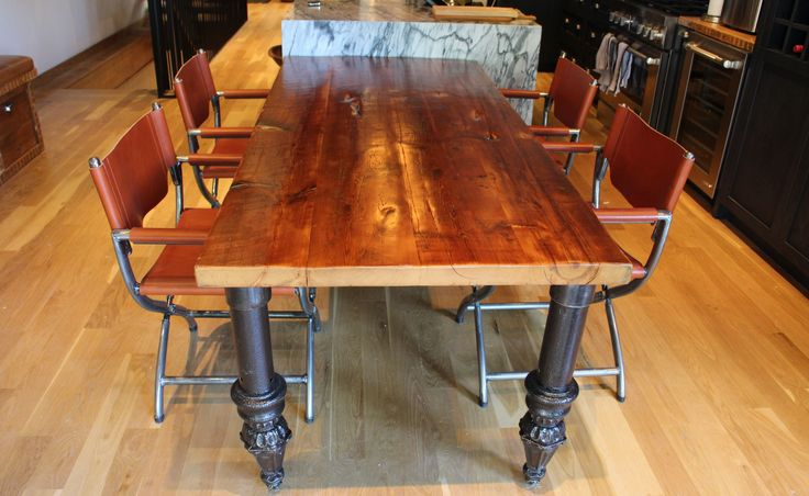 Reclaimed wood top table with salvaged cast steel legs