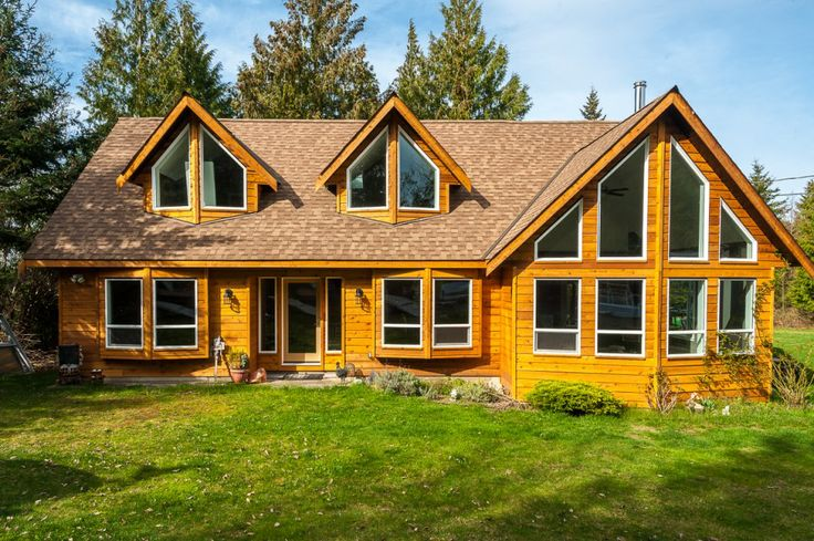 Two huge houses in qualicum bay for | $ 855,000 for the whole 5acre property.  With a mountain view!  They are private from each other and even have separate driveways. Yay!